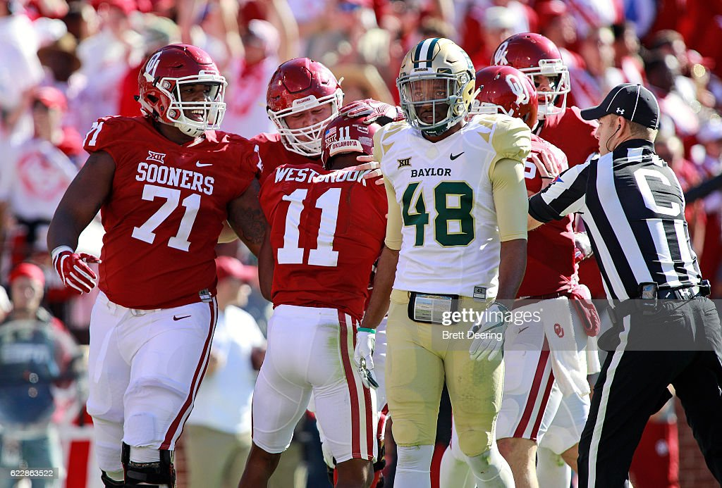 Defensive back Travon Blanchard #48 of the Baylor Bears walks away as the team celebrates wide receiver Dede Westbrook #11 of the Oklahoma Sooners touchdown November 12, 2016 at Gaylord Family-Oklahoma Memorial Stadium in Norman, Oklahoma. Oklahoma defeated Baylor 45-24.