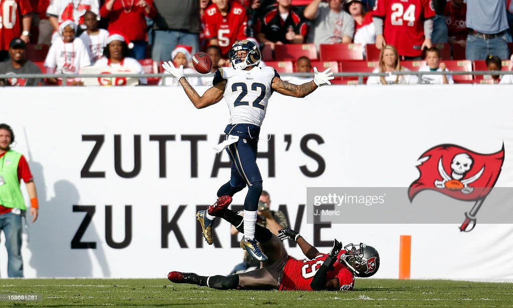 Defensive back <a gi-track='captionPersonalityLinkClicked' href=/galleries/search?phrase=Trumaine+Johnson&family=editorial&specificpeople=3915425 ng-click='$event.stopPropagation()'>Trumaine Johnson</a> #22 of the St. Louis Rams breaks up a pass intended for receiver Mike Williams #19 of the Tampa Bay Buccaneers during the game at Raymond James Stadium on December 23, 2012 in Tampa, Florida.