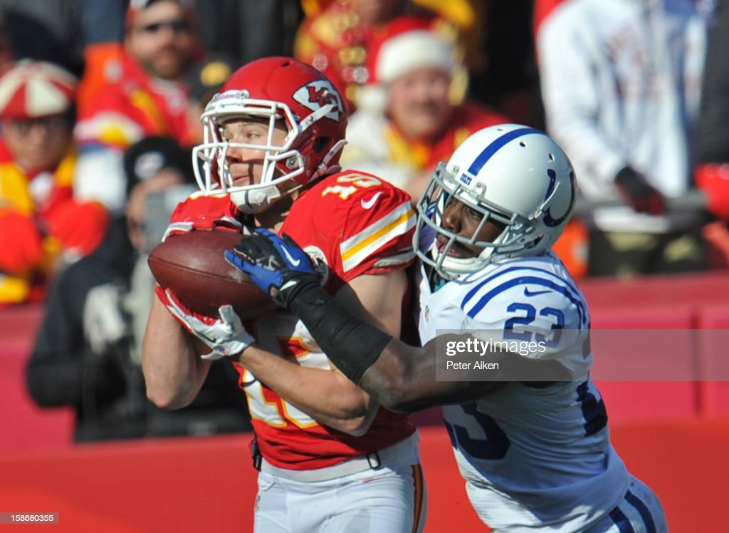 Defensive back Vontae Davis #23 of the Indianapolis Colts brakes up a pass intended for wide receiver Devon Wylie #19 of the Kansas City Chiefs during the first half on December 23, 2012 at Arrowhead Stadium in Kansas City, Missouri.