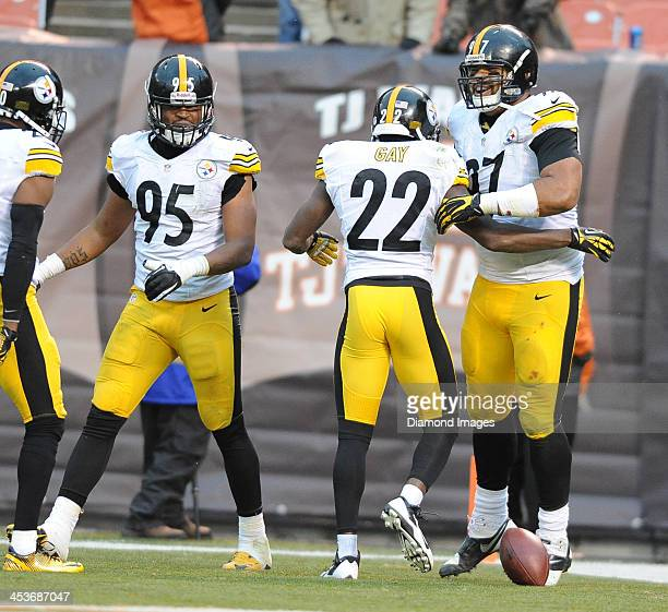 Defensive back William Gay and defensive linemen Cameron Heyward of the Pittsburgh Steelers celebrate in the end zone after a interception returned...