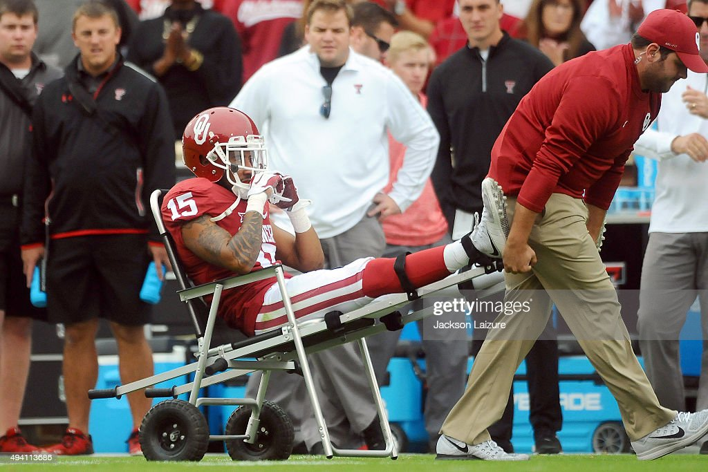 Defensive back Zack Sanchez #15 of the Oklahoma Sooners gets carted of the field in the game against the Texas Tech Red Raiders on October 24, 2015 at the Gaylord Family Oklahoma Memorial Stadium in Norman, Oklahoma.
