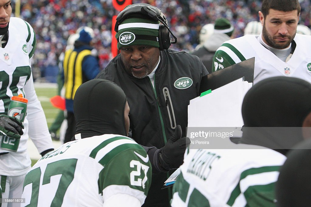 Defensive Backs Coach Dennis Thurman of the New York Jets talks on the bench during the game against the Buffalo Bills when the Buffalo Bills host the New York Jets at Ralph Wilson Stadium on December 30, 2012 in Orchard Park, New York.