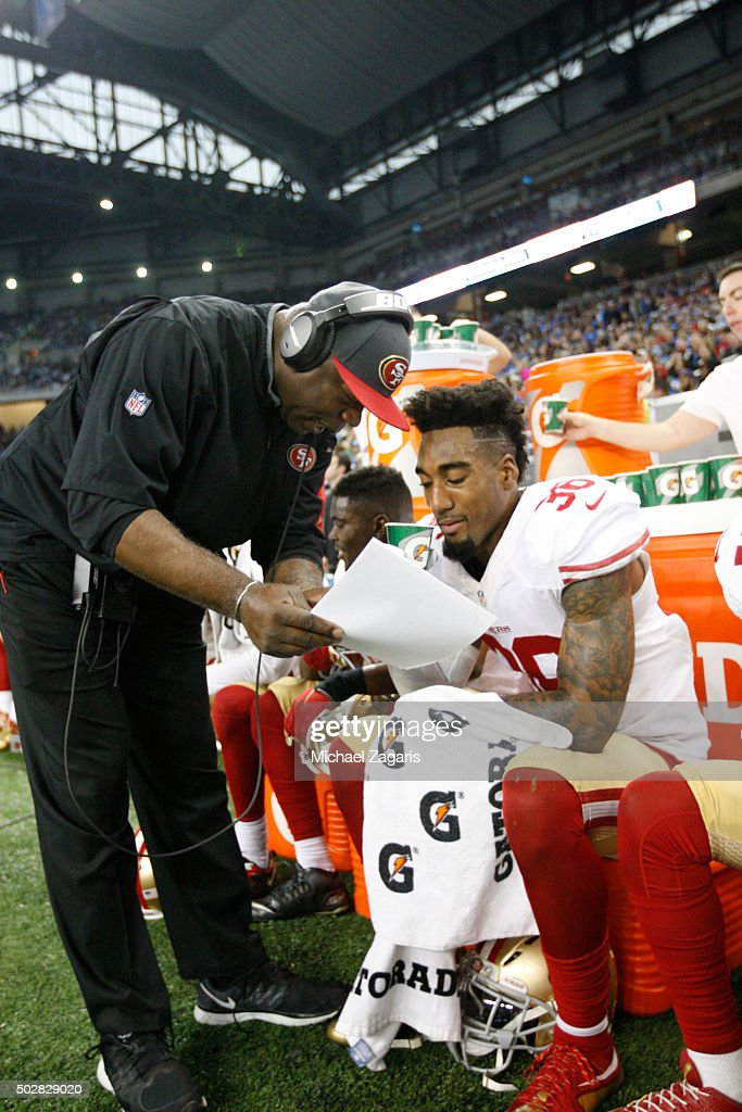 Defensive Backs Coach Tim Lewis of the San Francisco 49ers talks with <a gi-track='captionPersonalityLinkClicked' href=/galleries/search?phrase=Dontae+Johnson&family=editorial&specificpeople=7199526 ng-click='$event.stopPropagation()'>Dontae Johnson</a> #36 on the sideline during the game against the Detroit Lions at Ford Field on December 27, 2015 in Detroit, Michigan. The Lions defeated the 49ers 32-17.