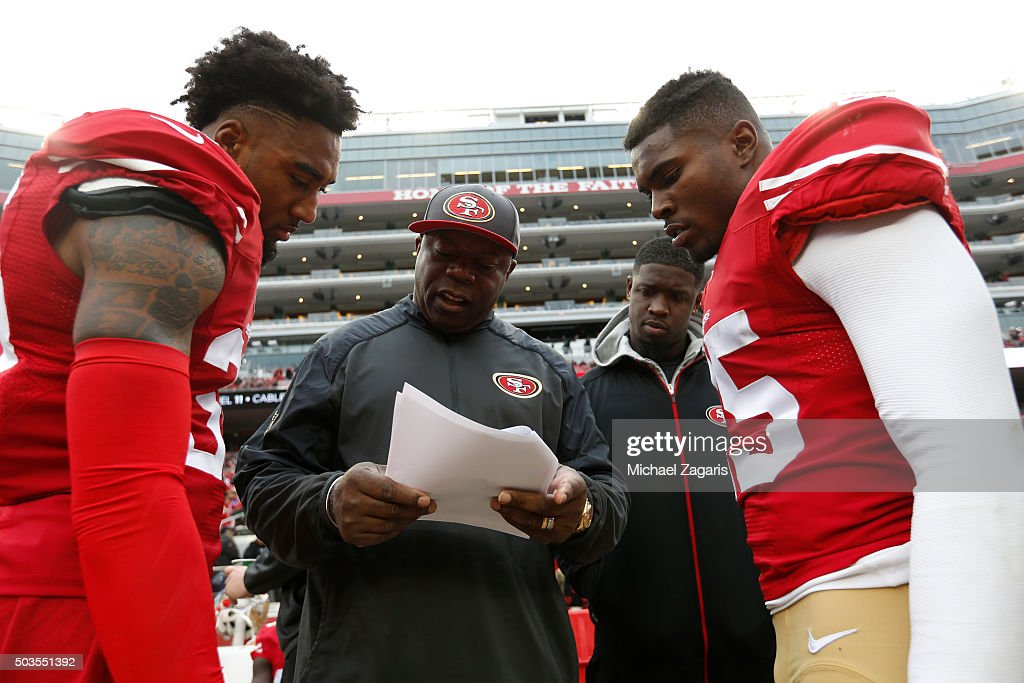 Defensive Backs Coach Tim Lewis of the San Francisco 49ers talks with <a gi-track='captionPersonalityLinkClicked' href=/galleries/search?phrase=Dontae+Johnson&family=editorial&specificpeople=7199526 ng-click='$event.stopPropagation()'>Dontae Johnson</a> #36, <a gi-track='captionPersonalityLinkClicked' href=/galleries/search?phrase=Jaquiski+Tartt&family=editorial&specificpeople=9989666 ng-click='$event.stopPropagation()'>Jaquiski Tartt</a> #29 and <a gi-track='captionPersonalityLinkClicked' href=/galleries/search?phrase=Jimmie+Ward+-+Joueur+de+football+am%C3%A9ricain&family=editorial&specificpeople=12685175 ng-click='$event.stopPropagation()'>Jimmie Ward</a> #25 on the sideline during the game against the St. Louis Rams at Levi Stadium on January 3, 2016 in Santa Clara, California. The 49ers defeated the Rams 19-16.