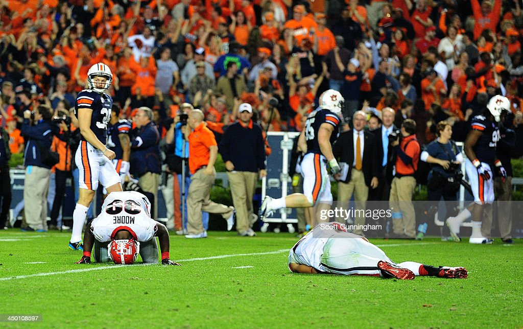 Defensive Backs Corey Moore #39 and Tray Matthews #28 of the Georgia Bulldogs lie on the ground stunned after giving up the go-ahead touchdown against the Auburn Tigers at Jordan-Hare Stadium on November 16, 2013 in Auburn Alabama.