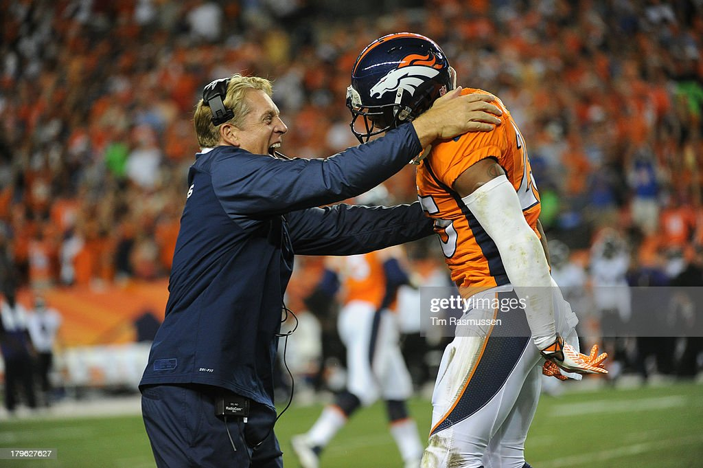 Defensive coach Jack Del Rio celebrates Denver Broncos cornerback Chris Harris's (25) interception in the second quarter. The Denver Broncos took on the Baltimore Ravens in the first game of the 2013 season at Sports Authority Field at Mile High in Denver on September 5, 2013.