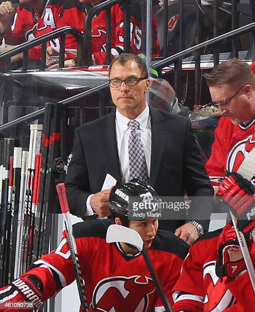 Defensive coach Scott Stevens of the New Jersey Devils look on against the Pittsburgh Penguins at the Prudential Center on December 29 2014 in Newark...