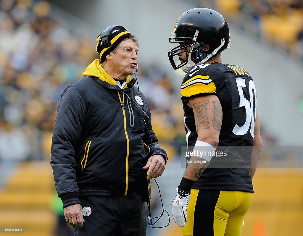 Defensive Coordinator Dick Lebeau of the Pittsburgh Steelers talks with <a gi-track='captionPersonalityLinkClicked' href=/galleries/search?phrase=Larry+Foote&family=editorial&specificpeople=213619 ng-click='$event.stopPropagation()'>Larry Foote</a> #50 during the third quarter against the San Diego Chargers on December 9, 2012 at Heinz Field in Pittsburgh, Pennsylvania.