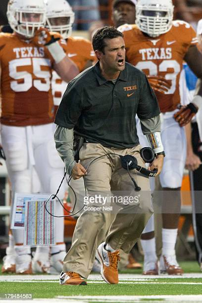 Defensive coordinator Manny Diaz of the Texas Longhorns encourages his team against the New Mexico State Aggies on August 31 2013 at Darrell K Royal...
