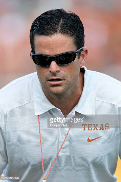 Defensive coordinator Manny Diaz of the Texas Longhorns looks on before kickoff against the New Mexico State Aggies on August 31 2013 at Darrell K...