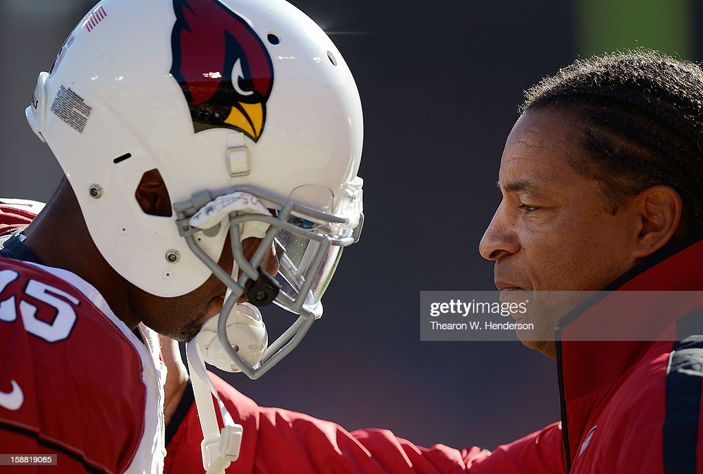 Defensive Coordinator Ray Horton of the Arizona Cardinals talks with defensive back Tarell Brown #25 during pre-game warm ups before their game against the San Francisco 49ers at Candlestick Park on December 30, 2012 in San Francisco, California.