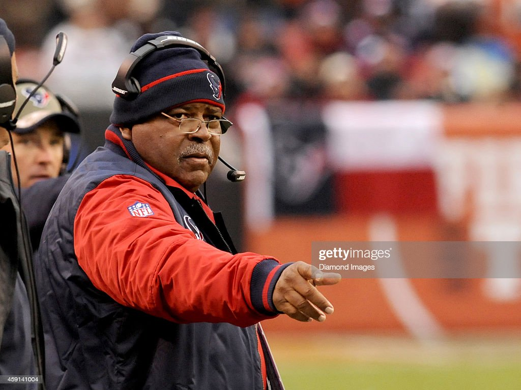 Defensive coordinator <a gi-track='captionPersonalityLinkClicked' href=/galleries/search?phrase=Romeo+Crennel&family=editorial&specificpeople=564028 ng-click='$event.stopPropagation()'>Romeo Crennel</a> of the Houston Texans points toward an official during a game against the Cleveland Browns on November 16, 2014 at FirstEnergy Stadium in Cleveland, Ohio. Houston won 23-7.