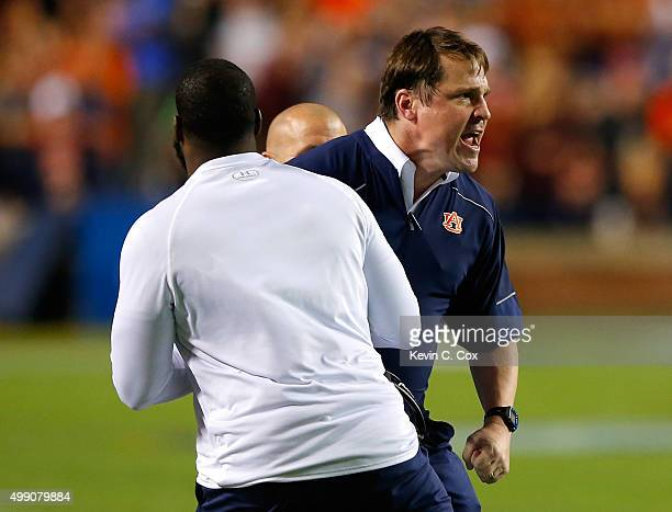 Defensive coordinator Will Muschamp of the Auburn Tigers is restrained on the sidelines during the game against the Alabama Crimson Tide at Jordan...