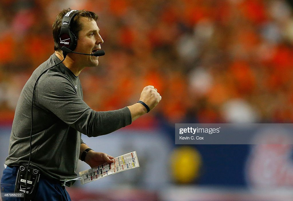 Defensive coordinator Will Muschamp of the Auburn Tigers yells to his defense against the Louisville Cardinals at Georgia Dome on September 5 2015 in...