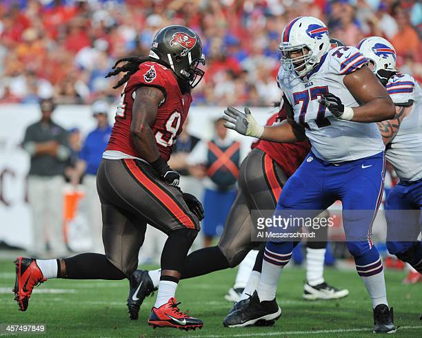 Defensive end Adrian Clayborn of the Tampa Bay Buccaneers rushes the pocket against the Buffalo Bills December 8 2013 at Raymond James Stadium in...