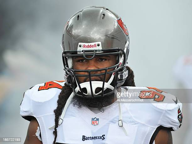 Defensive end Adrian Clayborn of the Tampa Bay Buccaneers sets for play against the New Orleans Saints September 15 2013 at Raymond James Stadium in...