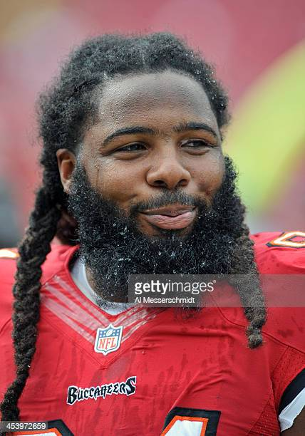 Defensive end Adrian Clayborn of the Tampa Bay Buccaneers warms up for play against the Atlanta Falcons November 17 2013 at Raymond James Stadium in...