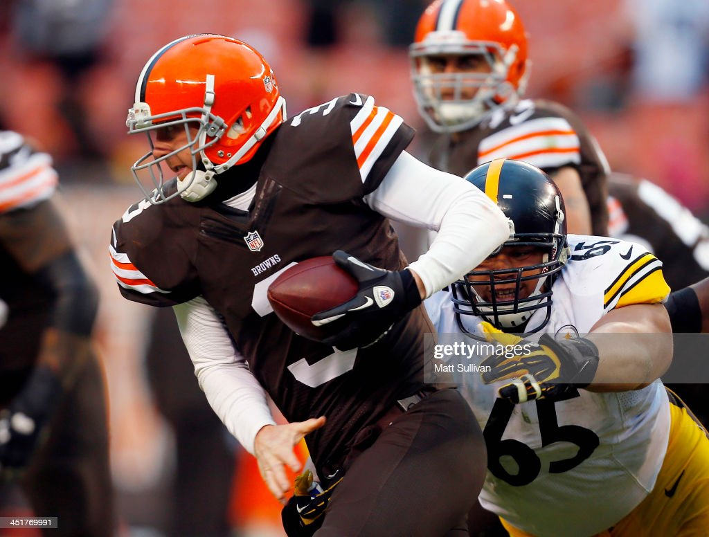 Defensive end Al Woods #65 of the Pittsburgh Steelers sacks quarterback <a gi-track='captionPersonalityLinkClicked' href=/galleries/search?phrase=Brandon+Weeden&family=editorial&specificpeople=7125737 ng-click='$event.stopPropagation()'>Brandon Weeden</a> #3 of the Cleveland Browns at FirstEnergy Stadium on November 24, 2013 in Cleveland, Ohio.
