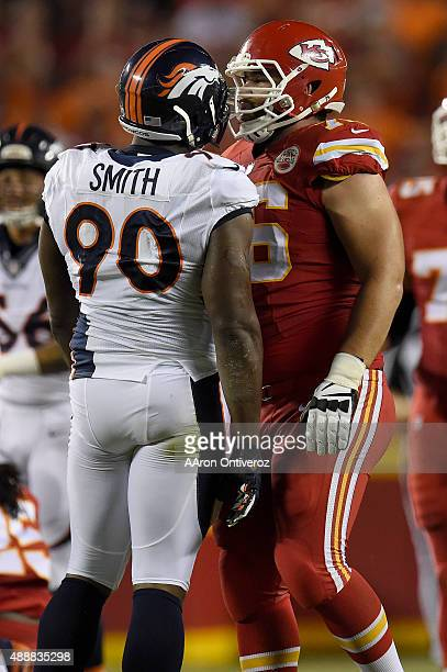 Defensive end Antonio Smith of the Denver Broncos and offensive guard Laurent DuvernayTardif of the Kansas City Chiefs jaw during the first half of...