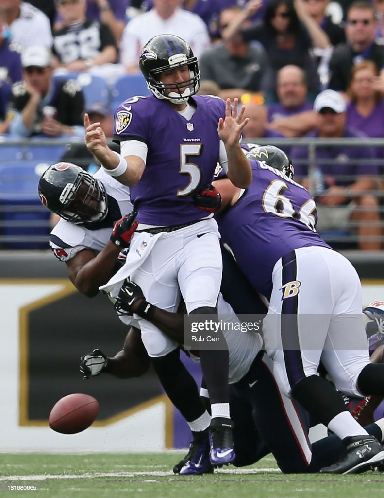 Defensive end Antonio Smith #94 of the Houston Texans knocks the ball out of the hands of quarterback <a gi-track='captionPersonalityLinkClicked' href=/galleries/search?phrase=Joe+Flacco&family=editorial&specificpeople=4645672 ng-click='$event.stopPropagation()'>Joe Flacco</a> #5 of the Baltimore Ravens during the first half at M&T Bank Stadium on September 22, 2013 in Baltimore, Maryland.