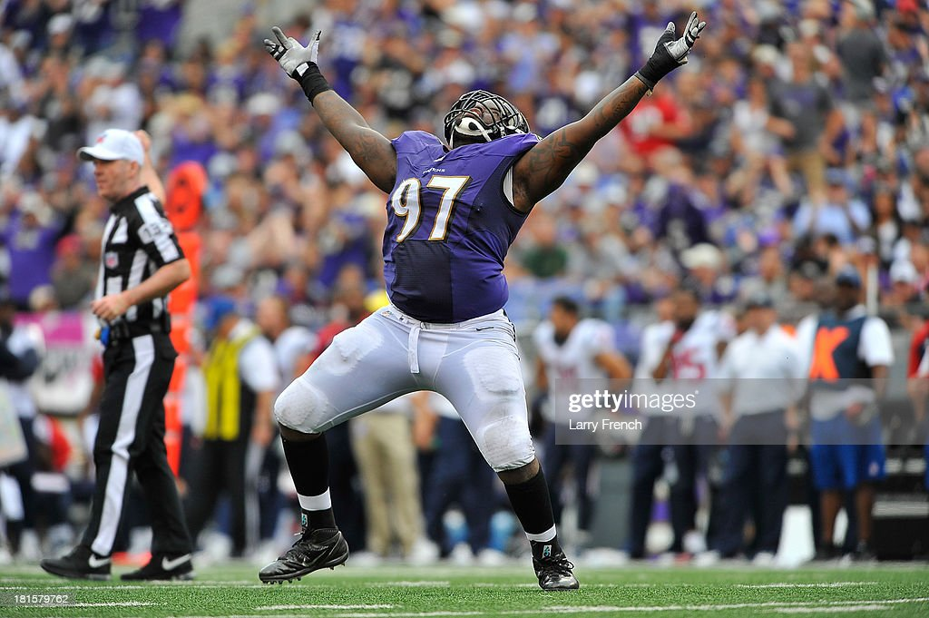 Defensive end Arthur Jones #97 of the Baltimore Ravens celebrates a sack against the Houston Texans at M&T Bank Stadium on September 22, 2013 in Baltimore, Maryland. The Ravens defeated the Texans 30-9.