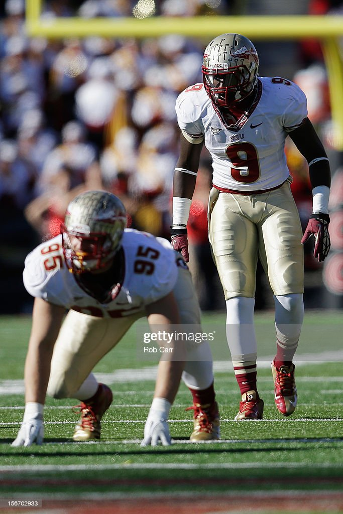 Defensive end Bjoern Werner #95 and defensive back Karlos Williams #9 of the Florida State Seminoles line up against the Maryland Terrapins offense at Byrd Stadium on November 17, 2012 in College Park, Maryland.