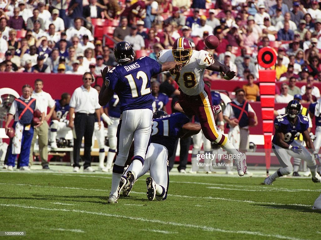 Defensive End Bruce Smith #78 of the Washington Redskins dove at Quarterback Tony Banks #12 of the Baltimore Ravens during a NFL game at FedEx Field on October 15, 2000 in Landover, Maryland. The Redskins won the game 10 to 3.