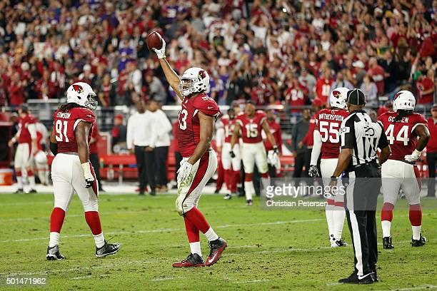 Defensive end Calais Campbell of the Arizona Cardinals celebrates after recovering a fumble during the final moments of the NFL game against the...