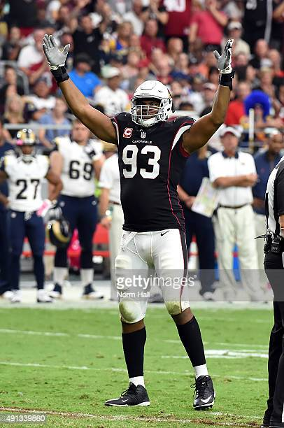 Defensive end Calais Campbell of the Arizona Cardinals gestures to fans during the second half of the NFL game against the St Louis Rams at...