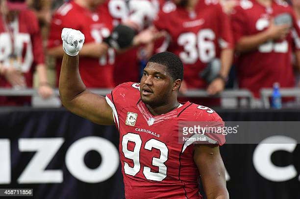 Defensive end Calais Campbell of the Arizona Cardinals holds up a fist in the first quarter of the NFL game against the St Louis Rams at University...