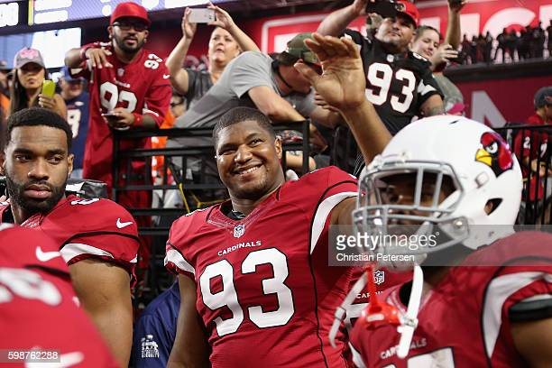 Defensive end Calais Campbell of the Arizona Cardinals prepares to take the field for the preseaon NFL game against the Denver Broncos at the...
