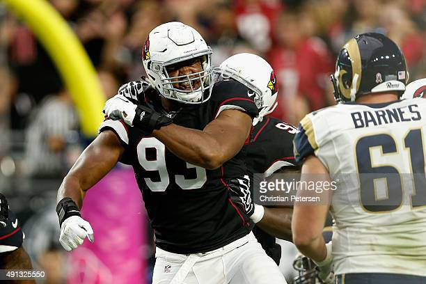 Defensive end Calais Campbell of the Arizona Cardinals reacts after a tackle during the first quarter of the NFL game against the St Louis Rams at...
