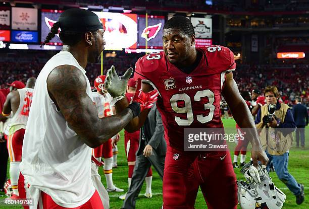 Defensive end Calais Campbell of the Arizona Cardinals shakes hands with wide receiver Dwayne Bowe of the Kansas City Chiefs after the NFL game at...