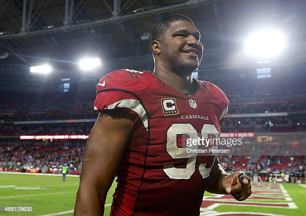 Defensive end Calais Campbell of the Arizona Cardinals walks off the field following the NFL game against the Detroit Lions at the University of...