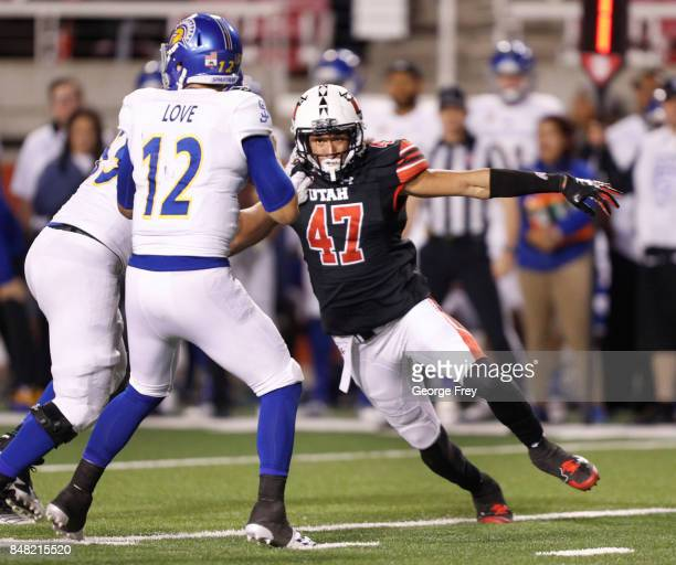 Defensive end Caleb Repp of the Utah Utes beats a block and looks to sack quarterback Josh Love of the San Jose State Spartans during the second half...