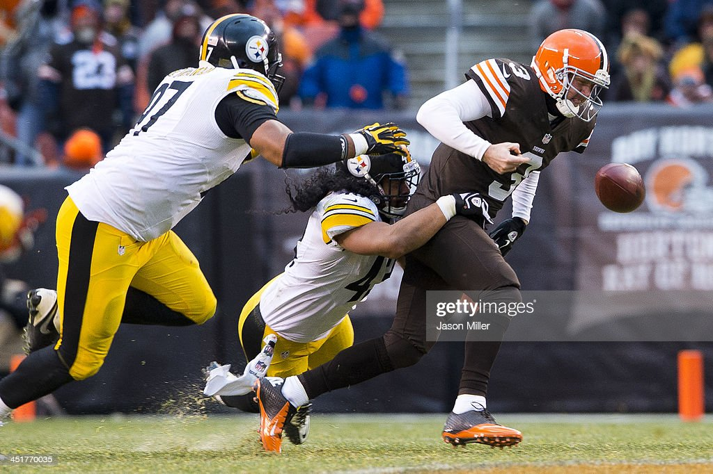 Defensive end <a gi-track='captionPersonalityLinkClicked' href=/galleries/search?phrase=Cameron+Heyward&family=editorial&specificpeople=4524172 ng-click='$event.stopPropagation()'>Cameron Heyward</a> #97 and strong safety <a gi-track='captionPersonalityLinkClicked' href=/galleries/search?phrase=Troy+Polamalu&family=editorial&specificpeople=206488 ng-click='$event.stopPropagation()'>Troy Polamalu</a> #43 of the Pittsburgh Steelers sack quarterback <a gi-track='captionPersonalityLinkClicked' href=/galleries/search?phrase=Brandon+Weeden&family=editorial&specificpeople=7125737 ng-click='$event.stopPropagation()'>Brandon Weeden</a> #3 of the Cleveland Browns during the second half at FirstEnergy Stadium on November 24, 2013 in Cleveland, Ohio. The Steelers defeated the Browns 27-11.