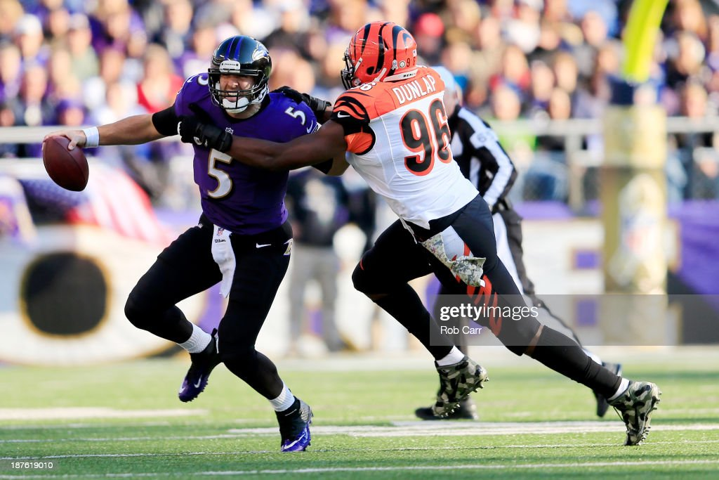 Defensive end <a gi-track='captionPersonalityLinkClicked' href=/galleries/search?phrase=Carlos+Dunlap&family=editorial&specificpeople=4489431 ng-click='$event.stopPropagation()'>Carlos Dunlap</a> #96 of the Cincinnati Bengals sacks quarterback <a gi-track='captionPersonalityLinkClicked' href=/galleries/search?phrase=Joe+Flacco&family=editorial&specificpeople=4645672 ng-click='$event.stopPropagation()'>Joe Flacco</a> #5 of the Baltimore Ravens during the second quarter at M&T Bank Stadium on November 10, 2013 in Baltimore, Maryland.