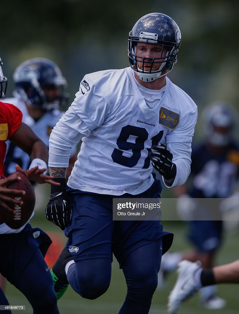 Defensive end <a gi-track='captionPersonalityLinkClicked' href=/galleries/search?phrase=Cassius+Marsh&family=editorial&specificpeople=7218813 ng-click='$event.stopPropagation()'>Cassius Marsh</a> #91 of the Seattle Seahawks defends during Rookie Minicamp at the Virginia Mason Athletic Center on May 17, 2014 in Renton, Washington.