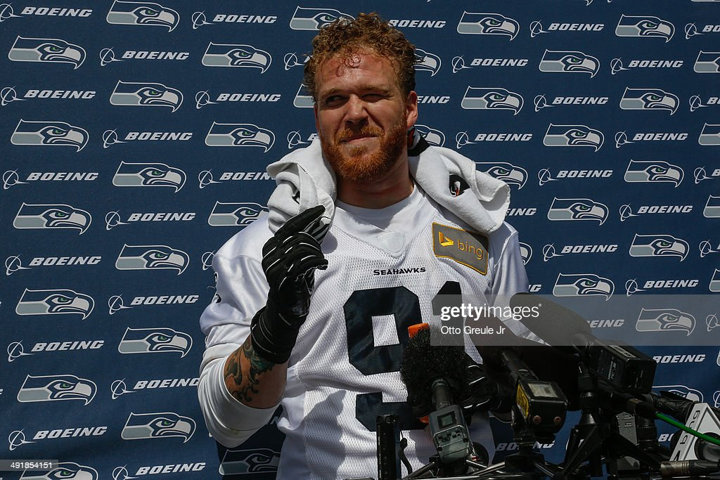 Defensive end <a gi-track='captionPersonalityLinkClicked' href=/galleries/search?phrase=Cassius+Marsh&family=editorial&specificpeople=7218813 ng-click='$event.stopPropagation()'>Cassius Marsh</a> #91 of the Seattle Seahawks speaks to the media during Rookie Minicamp at the Virginia Mason Athletic Center on May 17, 2014 in Renton, Washington.