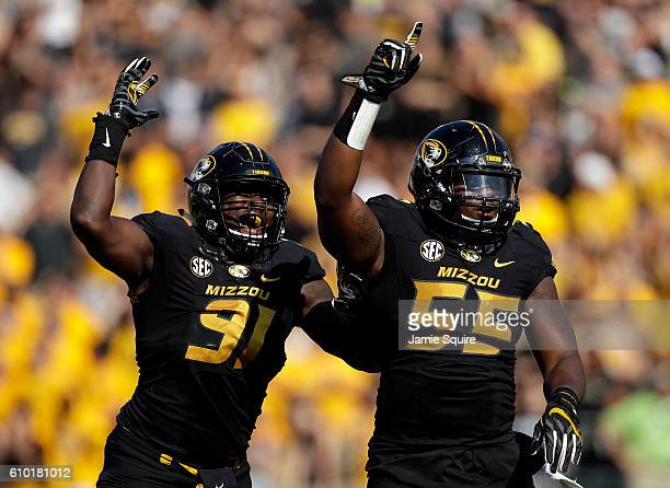 Defensive end Charles Harris and defensive lineman Jordan Harold of the Missouri Tigers celebrate after sacking quarterback Daniel Epperson of the...