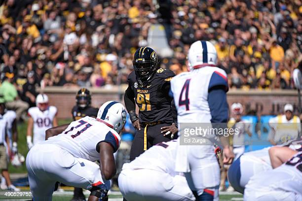 Defensive end Charles Harris of the Missouri Tigers lines up against the Connecticut Huskies at Memorial Stadium on September 19 2015 in Columbia...
