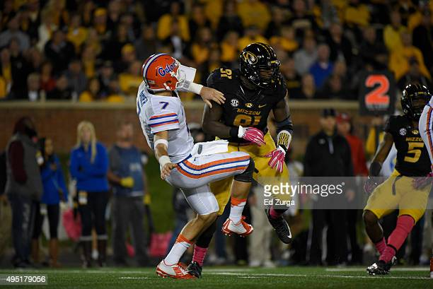 Defensive end Charles Harris of the Missouri Tigers puts a hit on Will Grier of the Florida Gators at Memorial Stadium on October 10 2015 in Columbia...