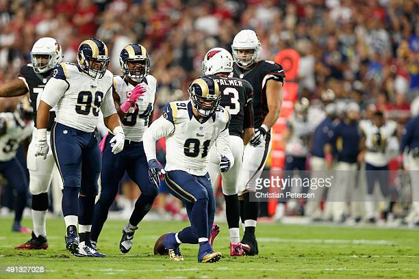 Defensive end Chris Long of the St Louis Rams celebrates a first quarter sack during the NFL game against the Arizona Cardinals at the University of...