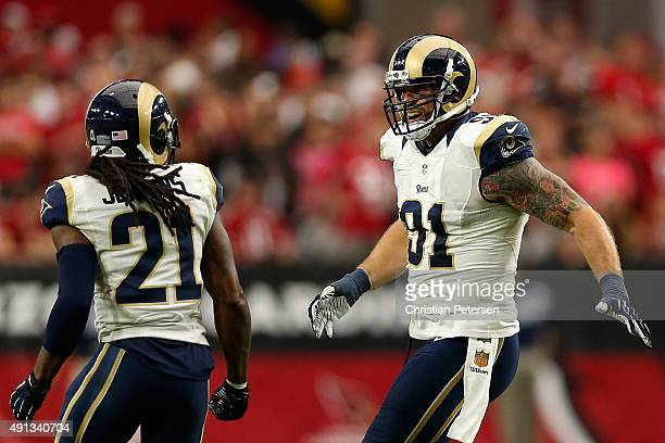 Defensive end Chris Long of the St Louis Rams celebrates with cornerback Janoris Jenkins after the Rams stoped the Arizona Cardinals on fourth down...