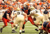 Defensive end Chris McKillop of the Pittsburgh Panthers causes a fumble against quarterback Perry Patterson of the Syracuse University Orange at the...