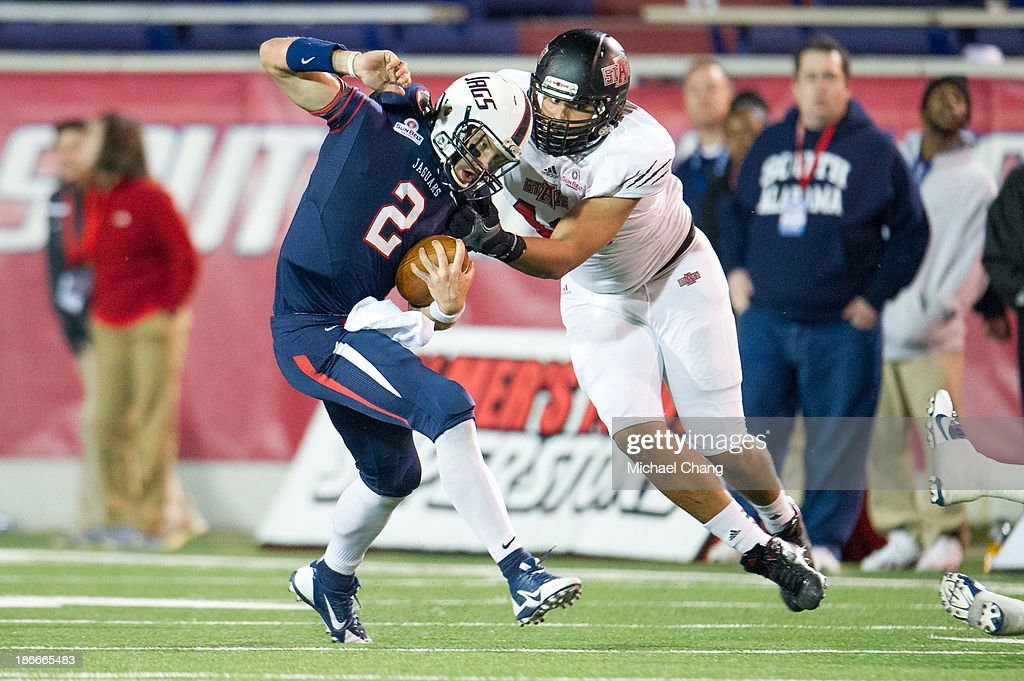 Defensive end Chris Stone #42 of the Arkansas State Red Wolves attempts to tackle quarterback Ross Metheny #2 of the South Alabama Jaguars on November 2, 2013 at Ladd-Peebles Stadium in Mobile, Alabama. Arkansas State defeated South Alabama 17-16.