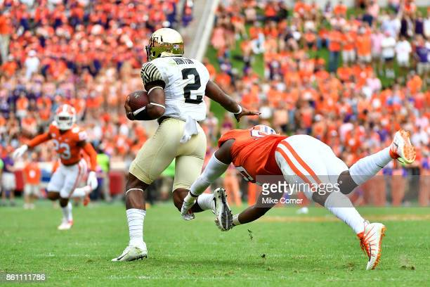 Defensive end Clelin Ferrell of the Clemson Tigers dives for quarterback Kendall Hinton of the Wake Forest Demon Deacons during the game at Memorial...