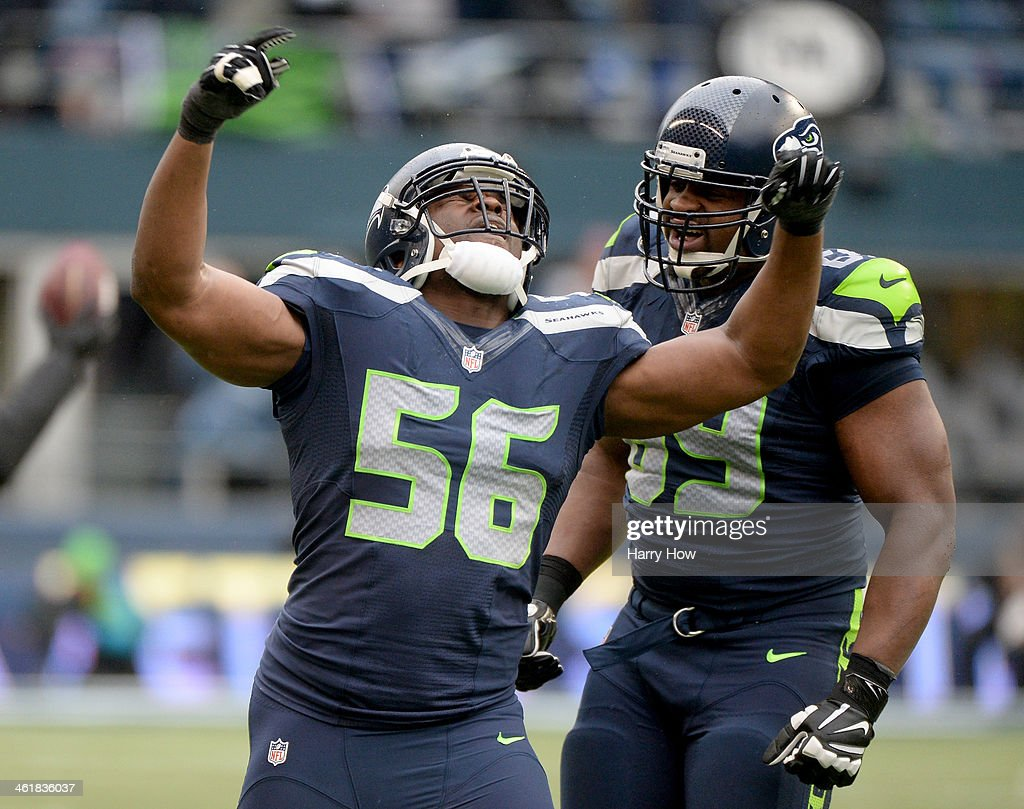 Defensive end Cliff Avril #56 of the Seattle Seahawks celebrates after stopping the New Orleans Saints in the third quarter during the NFC Divisional Playoff Game at CenturyLink Field on January 11, 2014 in Seattle, Washington.