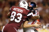Defensive end Cliff Matthews of the South Carolina Gamecocks sacks quarterback Jevan Snead of the Mississippi Rebels during their game at...