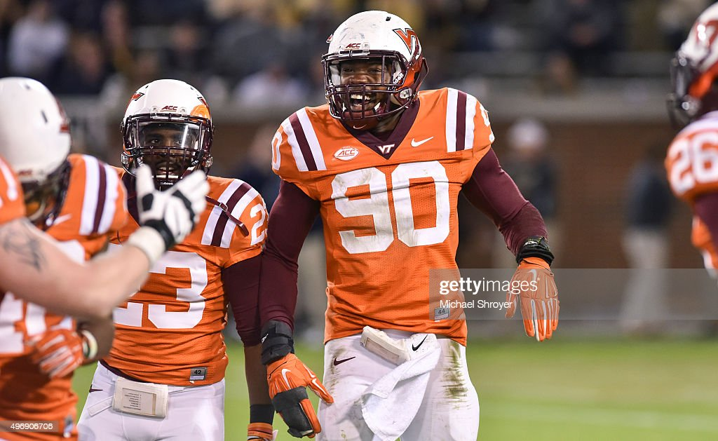 Defensive end <a gi-track='captionPersonalityLinkClicked' href=/galleries/search?phrase=Dadi+Nicolas&family=editorial&specificpeople=8599685 ng-click='$event.stopPropagation()'>Dadi Nicolas</a> #90 of the Virginia Tech Hokies celebrates a defensive stop in the second half against the Georgia Tech Yellow Jackets at Bobby Dodd Stadium on November 12, 2015 in Atlanta, Georgia. Virginia Tech defeated Georgia Tech 23-21.